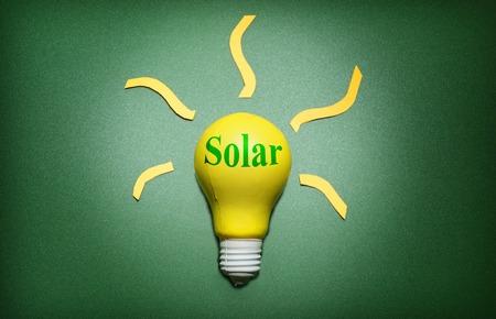 Solar light bulb on green - green energy concept