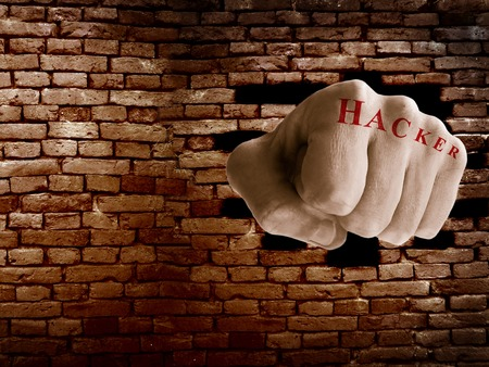 or shatter: Hacker fist punching thru a brick wall, online security or firewall concept