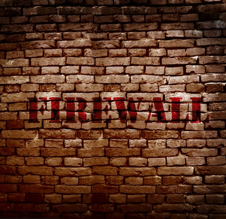 breakin: Firewall text on a brick wall -- Internet security concept