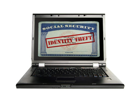 identities: Laptop with a Social Security card and Identity Theft text in red