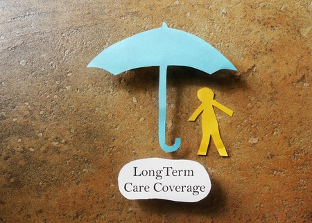 care: Paper person under an umbrella with Long Term Care Coverage text -- elder care insurance concept