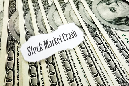 stock market crash: Stock Market Crash newspaper headline on hundred dollar bills Stock Photo