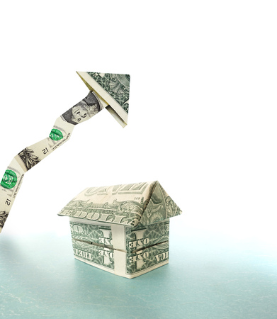 housing prices: Money house with upward pointing dollar arrow -- housing prices concept