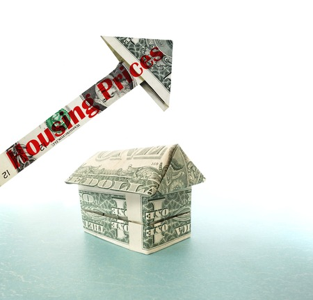 house prices: Dollar house with upward pointing Housing Prices arrow