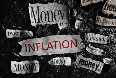 price uncertainty: Financial related newspaper headlines with Inflation in red Stock Photo