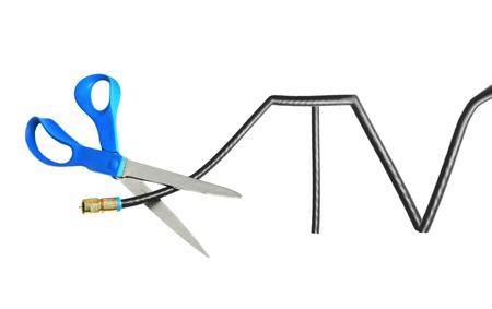cut: Scissors cutting through a TV shaped coaxial cable Stock Photo