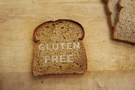 Slice of bread with Gluten Free label Imagens