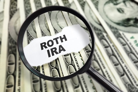 Magnified ROTH IRA message on hundred dollar bills Stock fotó - 46013605