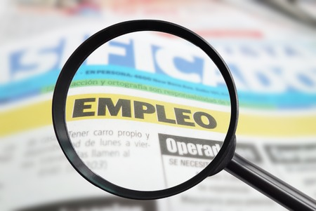 trabajo: Spanish newspaper classified employment  empleo  section with magnifying glass