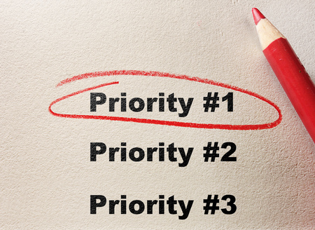 Priority 1 circled with red pencil Stockfoto