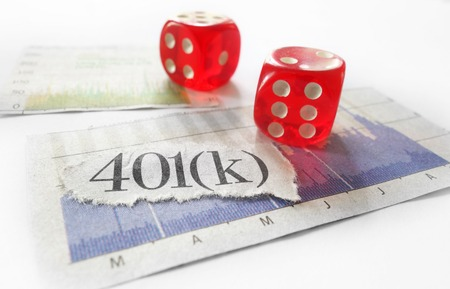 fluctuation: 401K newspaper headline with red dice and stock market charts