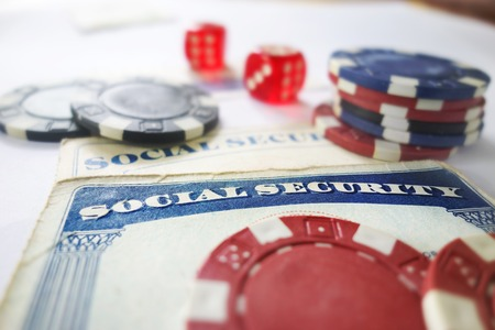 nestegg: Social Security cards with dice and poker chips