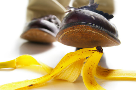 liability insurance: Man about to step on a banana peel -- accidental injury concept Stock Photo