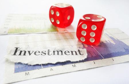 market crash: Investment newspaper headline on stock market charts with dice Stock Photo