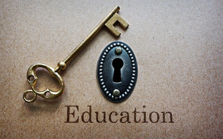 antique keyhole: antique gold key and key hole with Education message