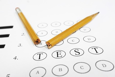 multiple choice: Multiple choice exam with TEST text and broken pencil. Frustration or learning disability concept