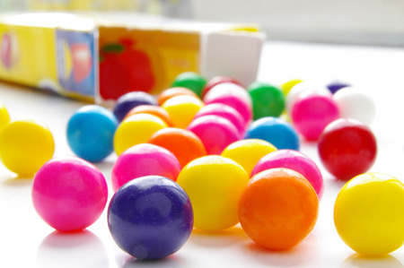 gumball: Assorted brightly colored candy gum balls and box