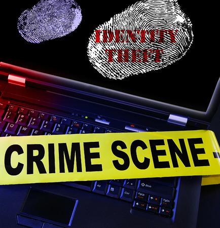identity theft: Identity Theft laptop fingerprint with crime scene tape