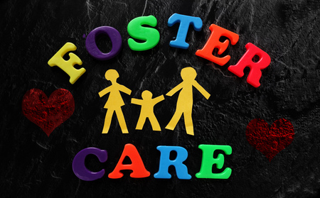 foster: Paper family with Foster Care letters and hearts