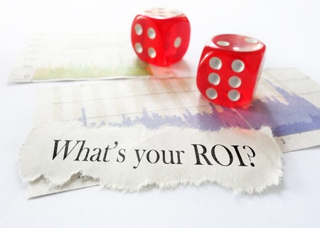 volatility: Whats Your ROI message with dice and charts Stock Photo
