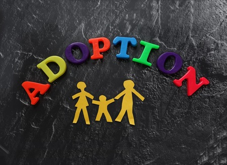 adopt: Paper cutout family with Adoption letters Stock Photo