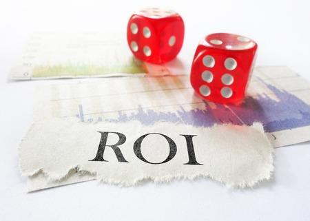 newspaper headline: ROI newspaper headline with dice and stock charts