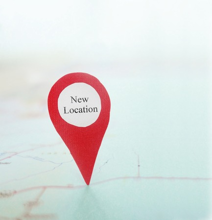 Localización nuevo pasador de localización en un mapa Foto de archivo
