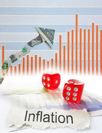 newspaper headline: Inflation newspaper headline with dice and up dollar arrow with graph