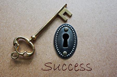 key hole: Success gold key and ornate key hole
