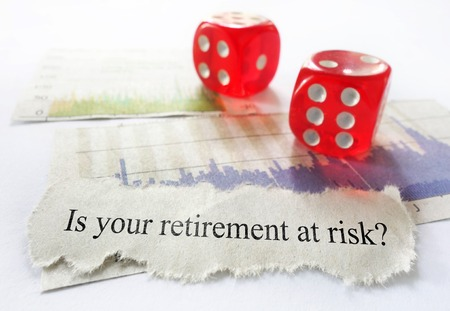 volatile: Retirement risk news headline with dice and stock market charts Stock Photo