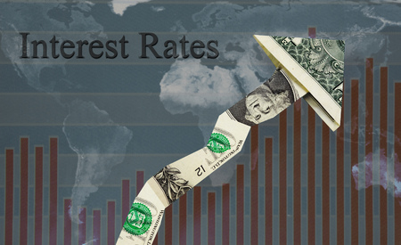 price uncertainty: Upward pointing Interest Rates dollar arrow over world map and chart