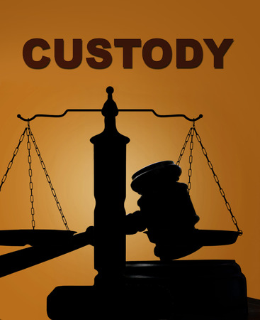 in custody: Court gavel and scales of justice silhouette with Custody text Stock Photo