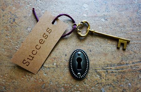 key hole: Key hole and key to success paper tag Stock Photo
