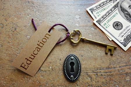 Gold Education key with money and keyhole -- Education is the key to success concept