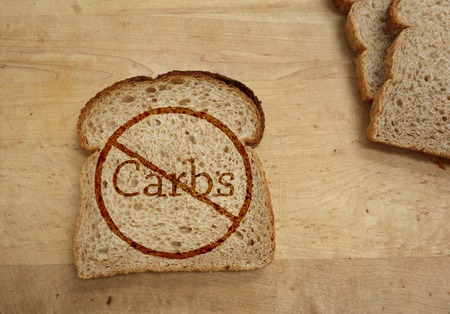 Slice of bread with Carbs ban, dietary concept