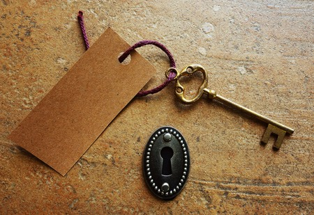 old fashioned: Gold key with tag and keyhole