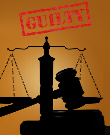 law suit: Court gavel and scales of justice silhouette with Guilty text Stock Photo