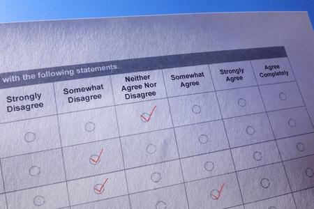 Customer feedback or business survey questionnaire with red checks Zdjęcie Seryjne