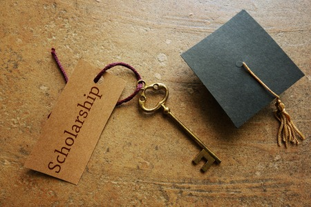 gold key: Gold key with Scholarship tag, with graduation cap