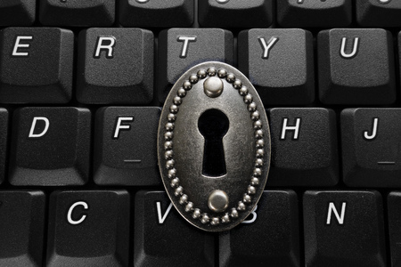lock with keyhole on computer keyboard -- data security concept