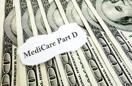 medicare: Newspaper Medicare Part D headline on money Stock Photo