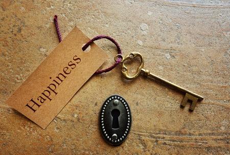Serrure avec clé d'or et le bonheur tag Banque d'images
