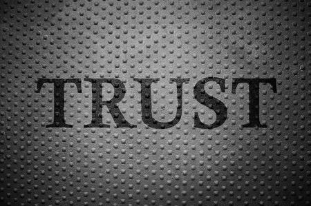 metal with round rivet pattern and Trust text Stok Fotoğraf