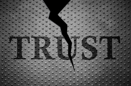 broken trust: metal with rivet pattern and broken Trust text Stock Photo