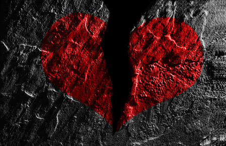 unfaithful: Broken red heart on textured background