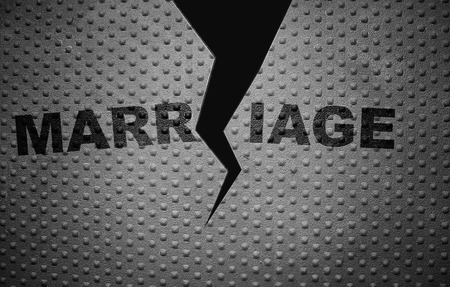 Cracked Marriage text on rivet metal background Banque d'images