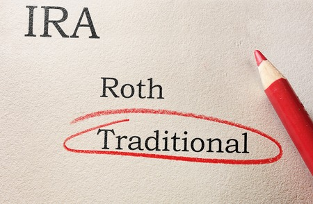 roth: Red circle and pencil with Roth and Traditional IRA text