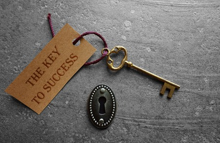 lock and key: The key to success with antique lock Stock Photo