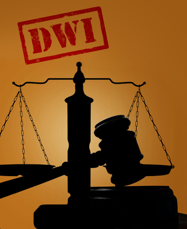 under arrest: Court gavel and scales with DWI text -- Driving while intoxicated concept