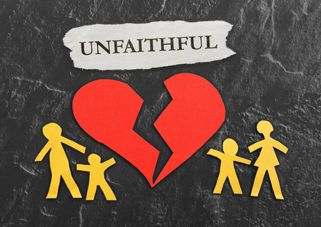 unfaithful: Paper family and broken red heart with Unfaithful message